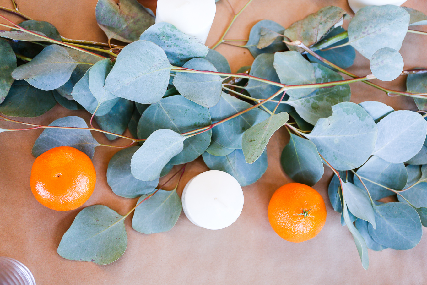 thanksgiving-decorations-of-eucalyptus-candles-oranges