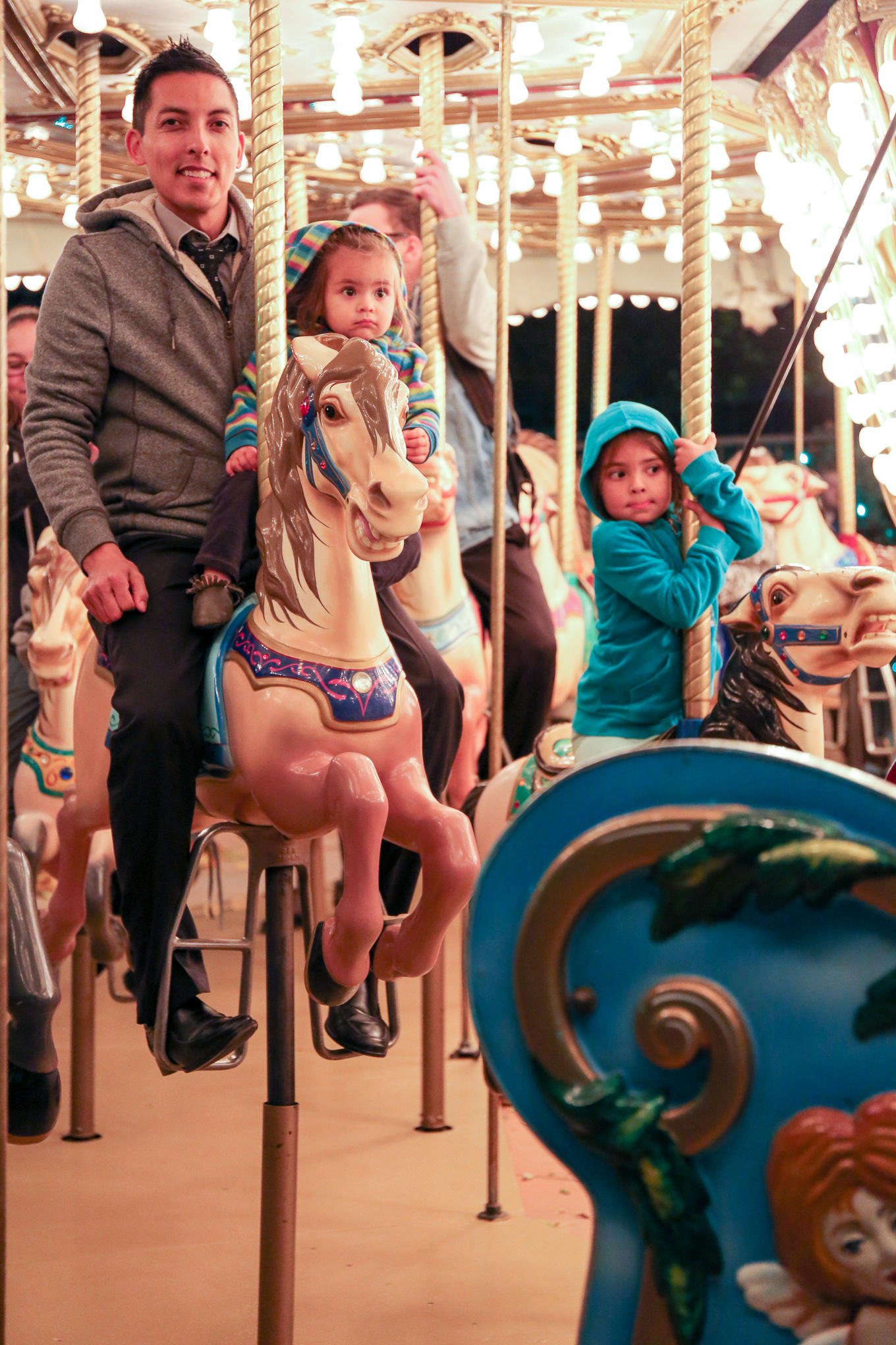 Dr. Smith with his family riding the carousel